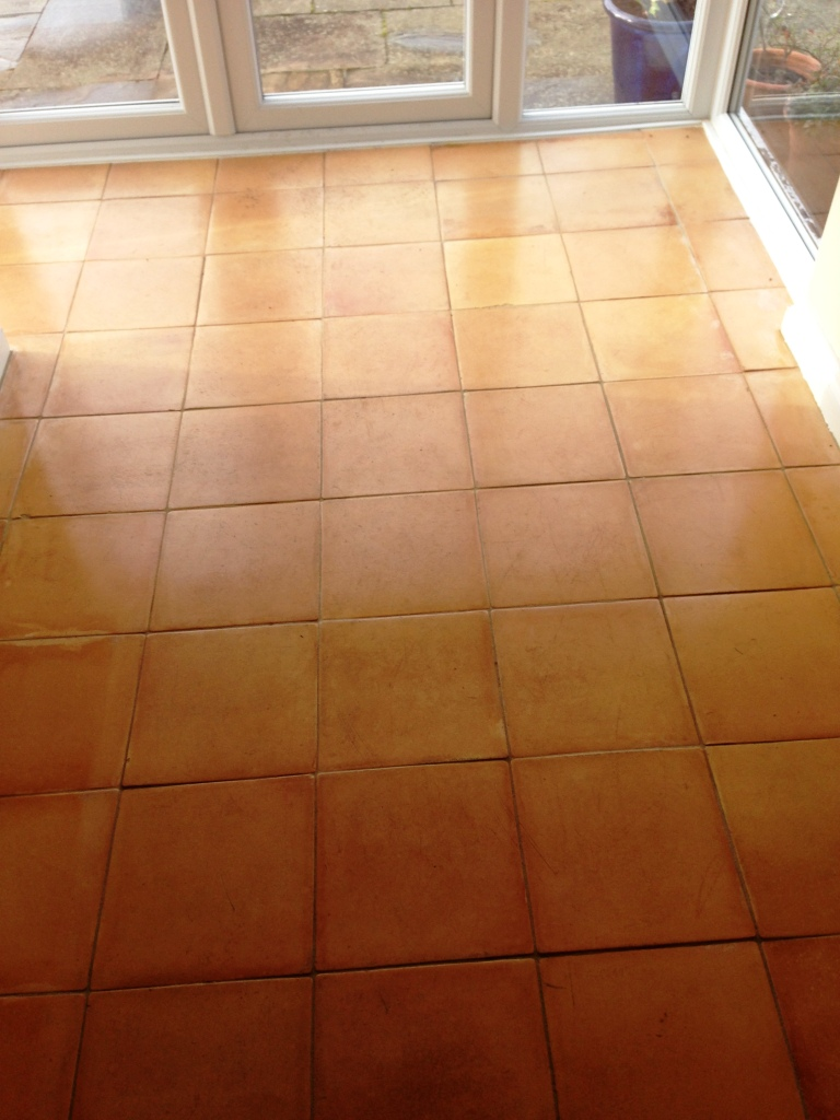Restoring the look of badly stained terracotta kitchen tiles in terracotta floor before cleaning and sealing in matlock dailygadgetfo Choice Image