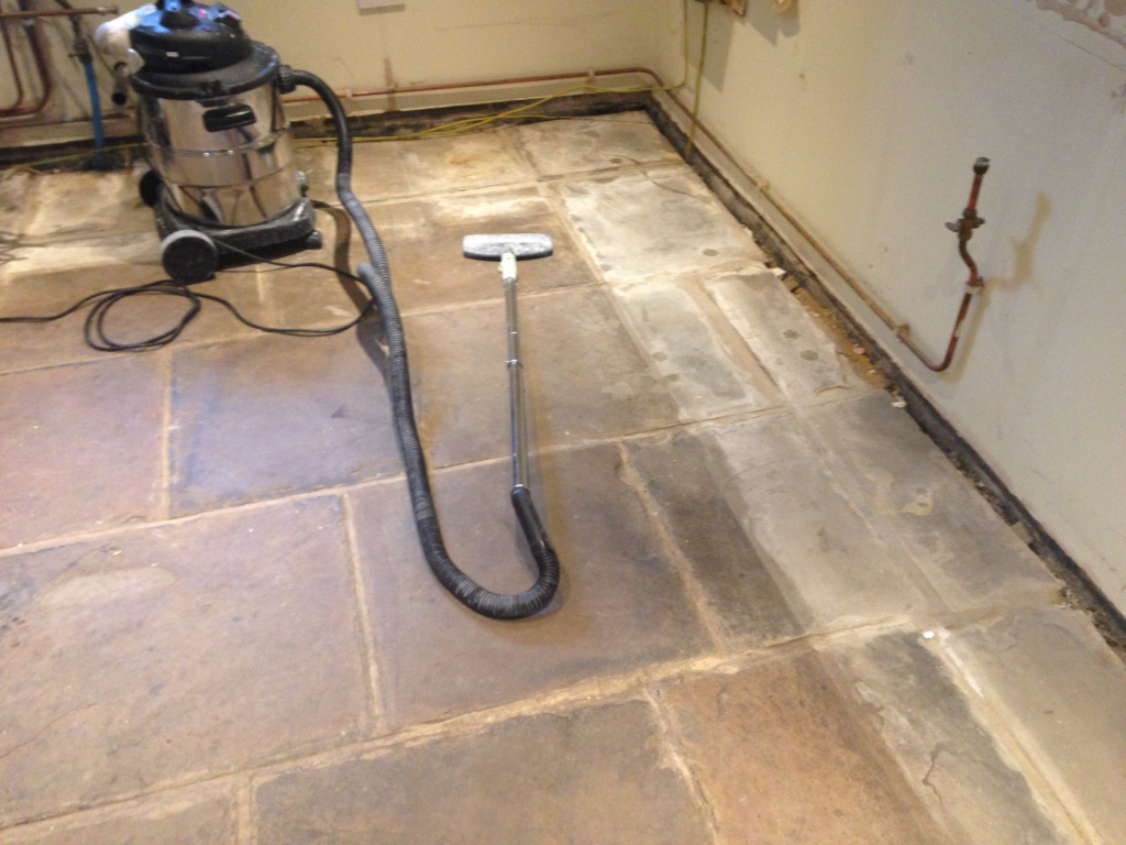 Yorkstone floor before cleaning and sealing in Deepcar Sheffield